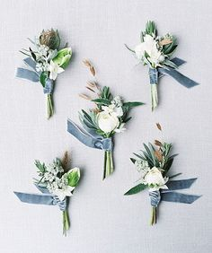 Beautiful boutonnières by @vervainflowers from @sarahhannamphoto. #winterwedding #weddingideas