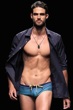 hommesnus:  trashyprinces:  Juan Betancourt at Carlos San Juan SS14.  Omg he looks amazing