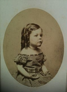 Young 1860s boy. Love the curls. American.