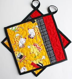 I just love these brightly colored fabrics and the whimsical chicken print!    The front of these potholders feature a chicken print on a yellow gold background. A black and white print and a solid red compliment the design. The back of the potholders are made from the same fun chicken print that is found on the front, and the black binding neatly wraps up the package.    Each potholder is made out of very high quality materials. Sandwiched between the outer layers are three layers of…