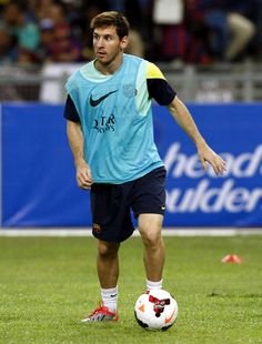 Lionel Messi of Barcelona FC controls the ball during Barcelona FC training session at Bukit Jalil National Stadium on August 9, 2013 in Kuala Lumpur, Malaysia.