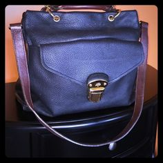 MULBERRY BLACK LEATHER TOTE  This purse is black and has brown straps and handles. Can carry or over shoulder. Beautiful gold accent pieces. It can be used as a laptop bag as well. Length is 18 inches across and 13 inches top to bottom. This bag is big and extra thick leather, the strap and handles can be removed. Outer clip has some scratching and handles have some wear but nothing bad at all. The bag has two outer closures and cell pockets inside along with three other compartments. 100%…