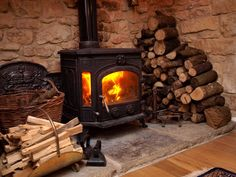 woodburner in large inglenook fireplace in thatched country cottage. Cosy Fireplace, Inglenook Fireplace, Stove Fireplace, Fireplace Design, Fireplaces, Irish Cottage, Cozy Cottage, English Country Cottages, Real Fire