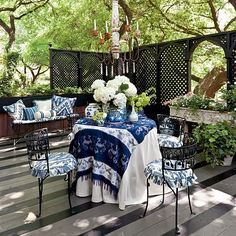 "beautiful outdoor room, navy blue just makes it ""POP"".    FROM Southern Living Magazine"