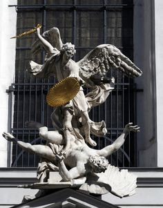 Sculpture of archangel Michael above the entrance of the Michaelerkirche in Vienna