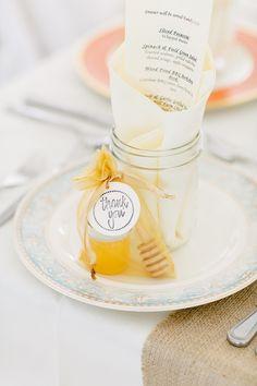 honey wedding favors at each place setting // photo by Kina Wicks // http://ruffledblog.com/romantic-illinois-farm-wedding