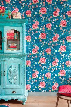 bright wallpaper, blue cabinet