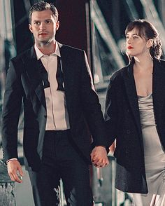 """Christian and Ana walking to his yacht """"The Grace"""""""