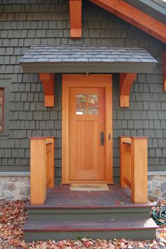 A small timbered overhang offers protection for the elements on the side entry to this Canandaigua Lake boathouse.