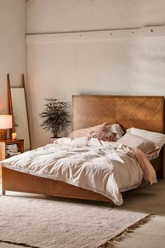 Sleek + lustrous, this bed frame is crafted from sustainable rubberwood with Okume veneer. Lifted bed frame featuring solid headboard + footboard in a natural finish with a slatted base. Wooden Canopy Bed, Wooden Headboards, Wooden Beds, Bed Frame And Headboard, Bed Frames, Boho Bed Frame, Bohemian Headboard, Feng Shui Bedroom, Apartment Furniture