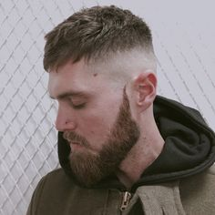 """French Crop"" - This haircut was made popular by French dudes. It's a High and Tight w/ a Fade everywhere except:  - the top is usually a good bit longer and usually tousled  - the front/sides are longer and combed forward  - the bangs are longest or even exaggerated, swept down and across the forehead."