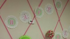 Pink and Lime green.  Birthday banner out of paper dollies and scrapbook paper.