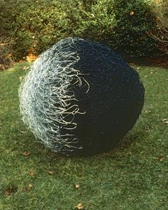 Large, modern, abstract sculpture. Transformation. Aluminum and steel wire, fiberglass mesh, steel rod. Sphere, white, silver, black, grass, landscaping, sculpture garden. www.nikiketchman.com #NikiKetchmanFineArt