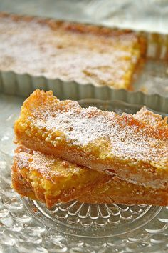 Creamy Lemon Bars Crust ½ C. confectioners' sugar 1 ½ C. unbleached flour Pinch of salt ¼ t. freshly ground nutmeg ¾ C. butter, cold and cubed Lemon Custard 4 eggs 1 ½ C. granulated sugar Zest of 1 lemon ½ C. freshly squeezed lemon juice ¾ C. Confectioners Sugar, Granulated Sugar, Unbleached Flour, Lemon Custard, Juice 3, Lemon Bars, How To Squeeze Lemons, Pound Cake, Goodies