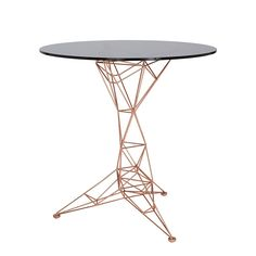 Inspired by bridges, towers and space frames, Pylon side table combines a hand welded copper‑plated steel rod base and a smoked glass top. This complimentary occasional piece is semi‑transparent and lightweight yet also structurally strong functional sculpture. Also available as a dining table, a coffee table and a coat stand.