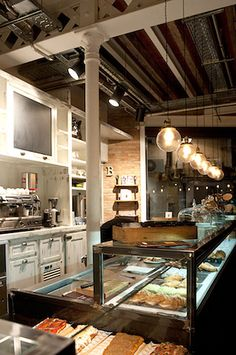 "funky bakery  ""Serrajòrdia"" located in the town of Sant Cugat del Valles near Barcelona. It was designed by interior design firm AM_Asociados and is a fantastic mix of industrial and vintage . Catalonia"