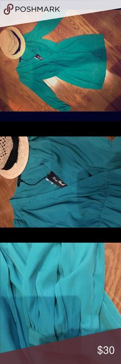 Teal sundress Comfortable flowy teal sundress with long sleeves and low v neck :) wear with sandals or pumps and a delicate layered necklace ! Great for the beach or a daytime occasion - Honey Punch Dresses Mini