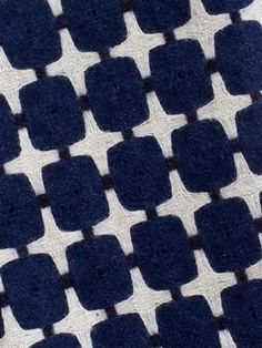 525 Line. - This dramatic reversible design references early television technology and draws its name from the number of scanning lines per inch for analogue American TV transmission. 100% wool. Colour: indigo, white and prussian blue. Blanket stitch edging in prussian blue. Standard size: 150 x 180 cm £230.00. Long size: approx 150 x 240 cm £296.00.