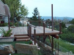 Open space under deck, what to do with it? Open space under deck, what Hillside Deck, Hillside Landscaping, Landscaping Ideas, Sloped Yard, Sloped Backyard, Backyard Decks, Living Pool, Outdoor Living, Outdoor Spaces