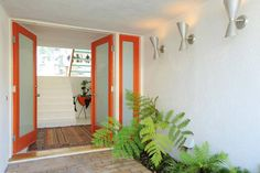 Love this entry - just enough orange to feel happy, and enough window to  let in lots of natural light