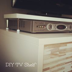 super easy tv shelf . so cable box can sit under the tv and the cabinet doors remain shut. 1 shelf and 4 door stoppers