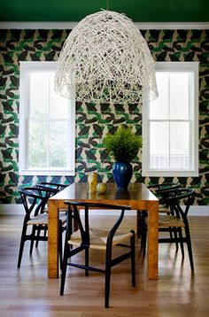 Angie Hranowsky Royall dining room... loving the wallpaper and wooden table.
