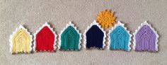 My very first pin of my own creations. Colourful crocheted beach huts, just need to decide how to display them now!