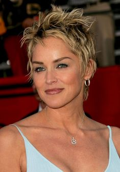 Layered tousled short pixie haircut for women over 50: Sharon Stone Hairstyles - http://hairstylesweekly.com
