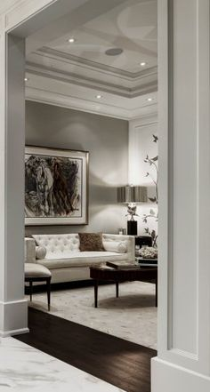 Great architectural details plus love the tufted sofa and soft neutral color scheme.