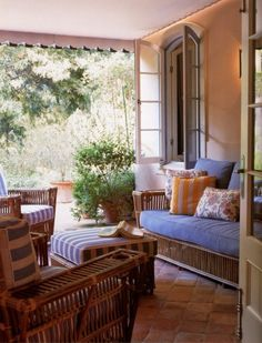 Michael S. Smith arranged a casual mix of vintage wicker covered in periwinkel on the veranda a Portuguese-style quinta in Montecio, Califor...
