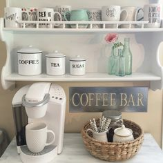 Spring coffee bar ☕️ I like the white canisters and the railing for the top shelf.  And also the basket for the miscellaneous stuff. Sb.