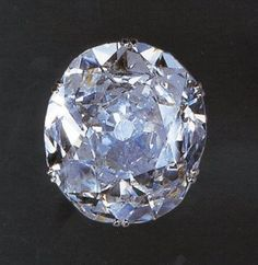 """The Koh-I-Noor diamond """"was once the most well-known throughout the world. Legend has it the """"Mountain of Light"""" was stolen from the Hindu god Krishna. Often, the spoils of war, the 186-carat diamond steadily passed among Hindu, Mughal, Persian, Afghan, and Sikh rules before being recut to 109 carats and added to the British Crown Jewels in 1877"""