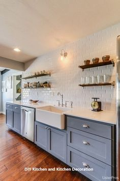 Time Home Flip Modern kitchen inspo! White tiled walls with a solid colour throughout the units make a clean and open kitchen area! White tiled walls with a solid colour throughout the units make a clean and open kitchen area! Kitchen Ikea, Kitchen Interior, Kitchen Dining, Kitchen Decor, Kitchen Storage, Cheap Kitchen, Kitchen Small, Kitchen Sink, Basement Kitchen
