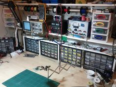 Electronics bench with bins and wire spool holder.