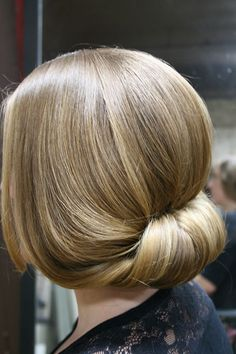 """Perfect for spring: a new twist on the """"faux-bob!"""" We've got the simple steps here: http://bit.ly/1mvseiS"""
