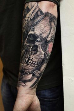 Skull forearm piece - by John Lewis of Life & Death Tattoos