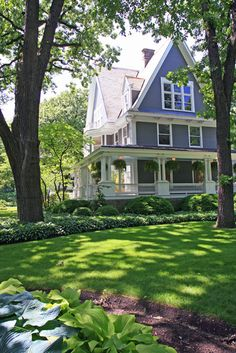 Big wraparound porch and lots of hostas makes great curb appeal.