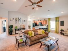 Highland Homes' Hawthorne features a fully-open living room with volume ceilings. Click to learn more!