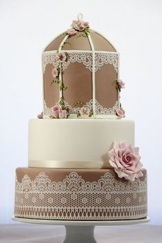 I dont love the dark color on this cake but i do looove the design....Vintage Birdcage Wedding