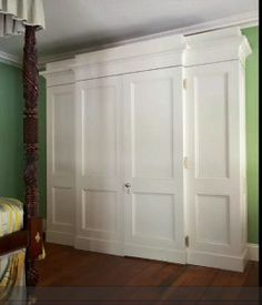 Built in wardrobe to hide a small powder room in a historical home. This could work as my new closet. Cute.