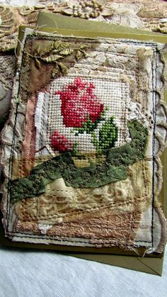 Great idea for using mama's unframed cross-stitch pieces. Embroidery Fabric, Fabric Art, Embroidery Stitches, Fabric Crafts, Fabric Books, Textiles, Fabric Journals, Art Journals, Cross Stitch Rose