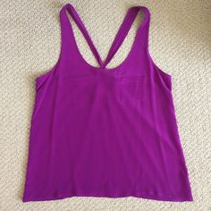 NWOT Forever 21 silk top with strappy back NWOT Forever 21 purple silk top with strappy back. 100% silk. Dry clean only. Pocket detail on front. Forever 21 Tops