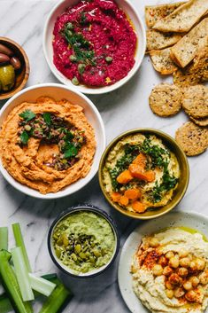 Five Different Hummus Recipes for Spring - Roasted Carrot Hummus, Beet Hummus, Avocado Hummus, Roasted Garlic Hummus, and Sun Dried Tomato Hummus!