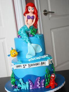 The Little Mermaid theme cake, with edible gumpaste Ariel figurine, Sebastian figurine and Flounder figurine cake toppers. All handmade.  www.thecakinggirl.ca