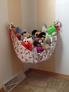 diy stuffed animal hammock with a fitted sheet and some 3M hooks - brilliant!