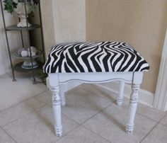 Stool from Goodwill.  Painted White with Gray Glaze and new Zebra Fabric.