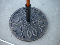 A rust free patio umbrella base that has the look of a cast iron umbrella stand means less staining on your pool deck.
