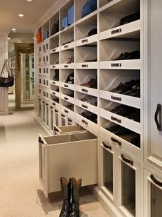 Woodmeister Master Builders: Enviable, custom closet with wall to wall carpeting and glass fronted boot drawers! Pull ...