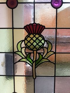 Stained glass thistle used on the side panel of a front door