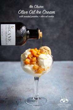 This No Churn Olive Oil Ice Cream with Roasted Peaches and Olive Oil Cookies uses Carapelli Organic Extra Virgin Olive Oil for a luscious, rich, and totally easy dessert! Only four (4!) ingredients and five minutes of prep are needed for the ice cream. Carapelli®️️ Extra Virgin Olive Oil has a genuine and balanced taste with a lovely peppery finish, along with being organic, non-GMO, and super high quality. An absolute star in this dessert! #icecream #carapelli